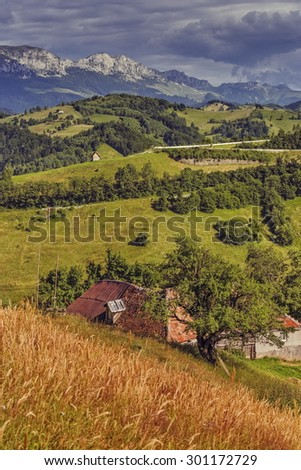 Peaceful rural landscape with traditional Romanian house in the valleys of the Bucegi mountains in Pestera village, Brasov county, Romania. Travel destinations. - stock photo