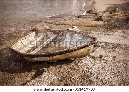 Peaceful scene in the morning, with a fishing boat ,on the shore of the Capri Island - stock photo