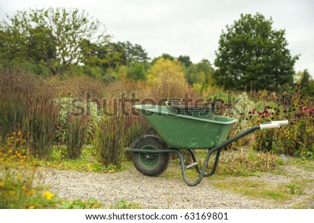 Peaceful scene with garden wheelbarrow in English country garden setting