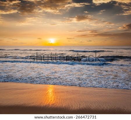 Peaceful serene morning on beach - stock photo