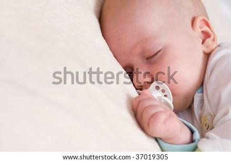 Peaceful sleeping beautiful baby - stock photo