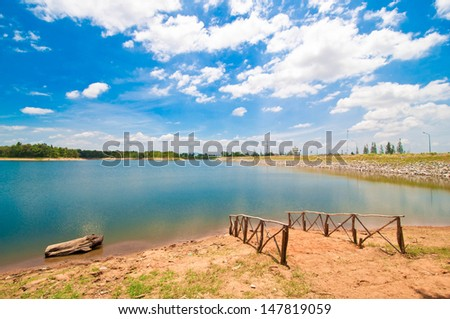 Peaceful summer rural landscape with a water reservoir
