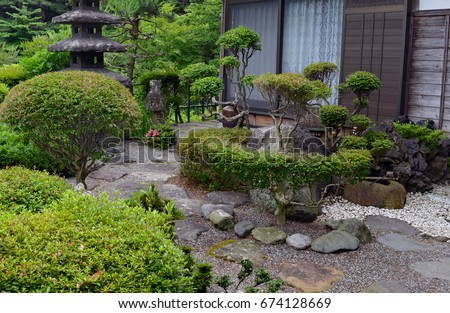 Topiary landscaping formal english garden stock photo for Typical japanese garden plants