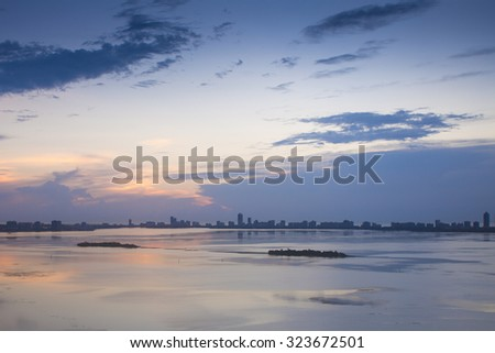 Peaceful view of downtown Miami at twilight, taken from Biscayne Nature Reserve. - stock photo