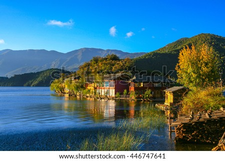 Peaceful view of the Lugu lake and the village in the morning sunshine, Yunnan Province, China.