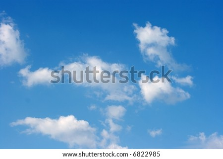 Peaceful white clouds on deep blue sky - stock photo