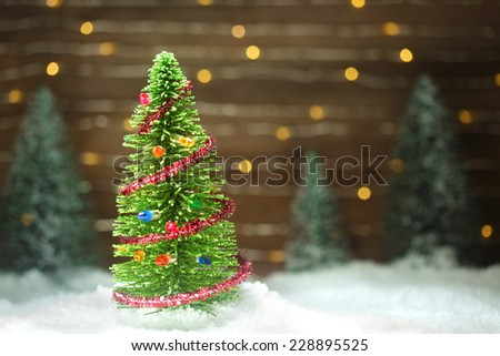 Peaceful winter scene with Christmas tree - stock photo