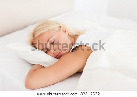 Peaceful woman sleeping in her bedroom - stock photo