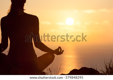 Peaceful yoga by the sea. - stock photo