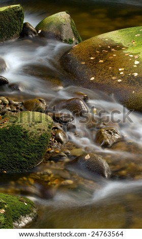 Peacefull water in the brook - stock photo