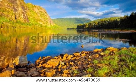 Peacful lake on a warm summer day - stock photo