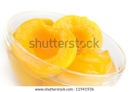 Peach halves in light syrup - stock photo