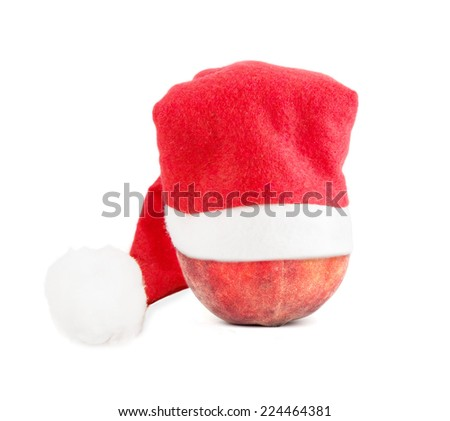 peach in a Christmas hat isolated - stock photo