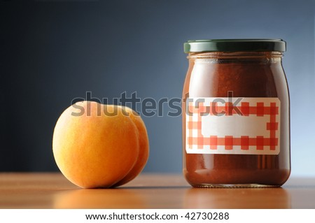 peach jam in a labelled not branded can - stock photo
