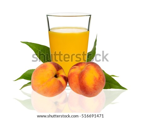 peach juice in a glass with peaches on a white background