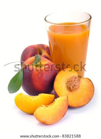 peach juice in a jug and a glass of fruit - stock photo