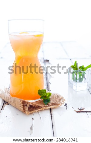 Peach Lemonade on a white rustic wooden background - stock photo