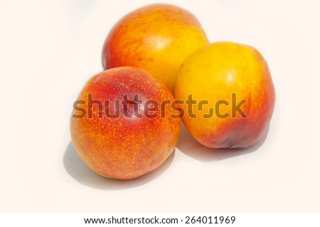 peach. nectarine. a peach of a variety with smooth, thin, brightly colored skin and rich firm flesh. - stock photo