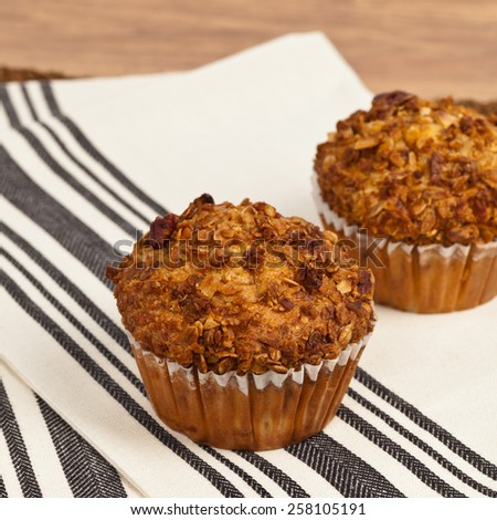 Peach Pecan and Granola Muffins. Selective focus. - stock photo