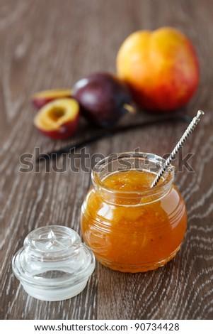 Peach-plum homemade jam with vanilla - stock photo