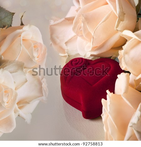 Peach roses with heart red box on soft background - stock photo