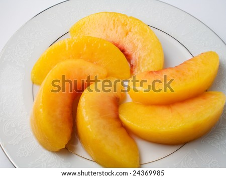 Peach slices on saucer ready to eat or serve - stock photo