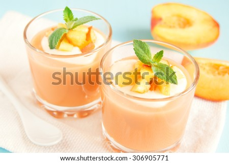 Peach smoothie dessert (mousse) with yogurt and mint in portion glasses - stock photo