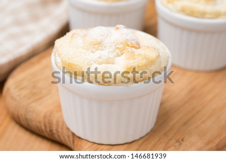 peach souffle in the portioned form on a wooden board, close-up - stock photo