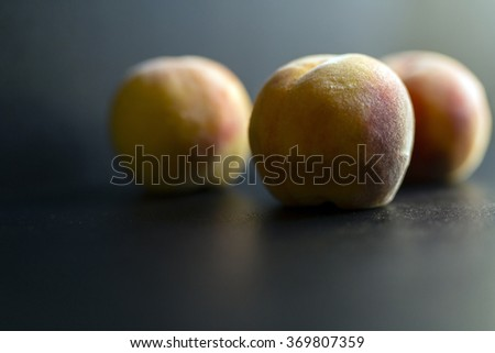 Peaches and a black background