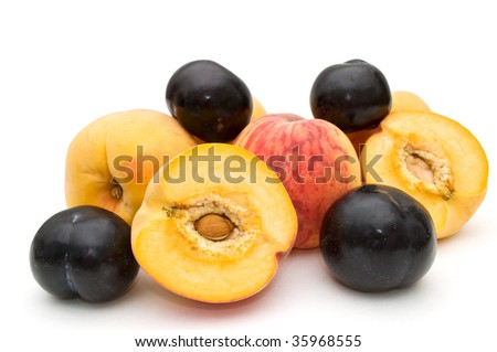 Peaches and plums on a white background.