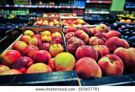 peaches at the grocery store - stock photo