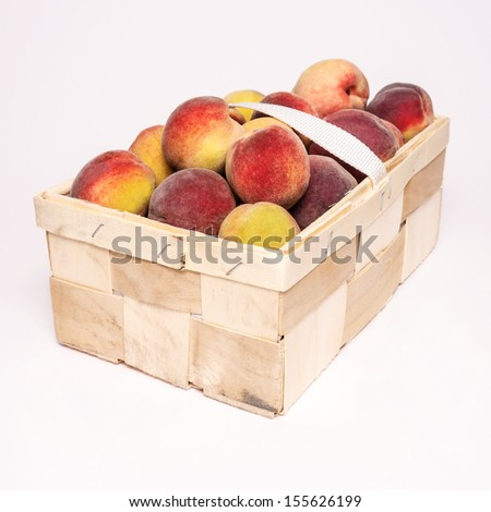 peaches in basket on white background
