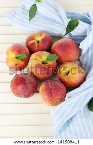 Peaches on napkin on wooden table