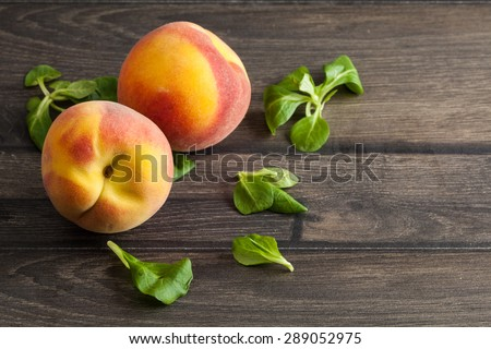peaches on rustic wooden table background - stock photo