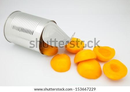 peaches tinned on white fund - stock photo