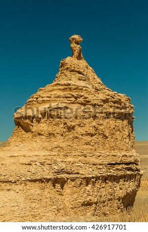 Peacock figure in the Gobi Desert, south of the Dunhuang city, Gansu Province, Western China. - stock photo