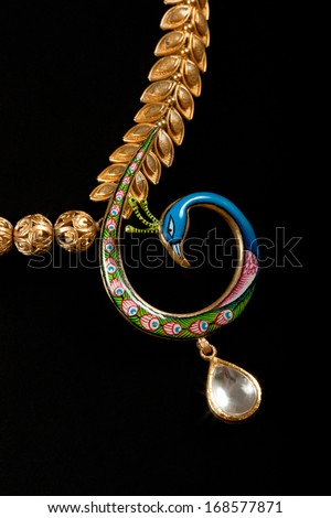 peacock style   Diamond necklace with pendent over black background - stock photo