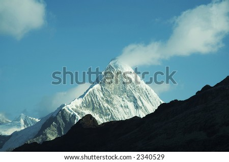 Peak Caraz and white cloud in Cordilleras mountain