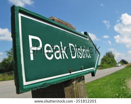 Peak District signpost along a rural road - stock photo