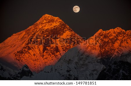 Peak Everest (8848 m) on the sunset in a full moon from Gokyo Ri (5483 m). Nepal, Himalayas. Canon EOS 5D Mark II. - stock photo