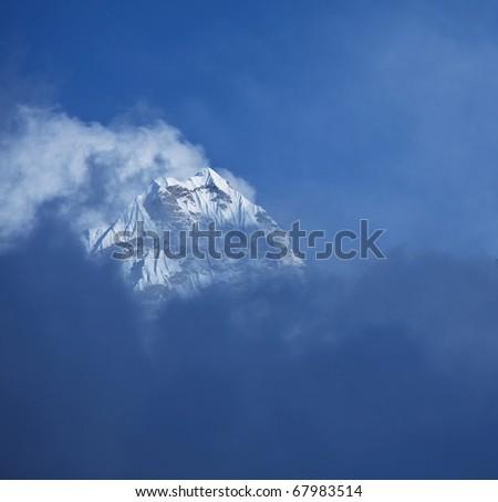 peak in clouds - stock photo