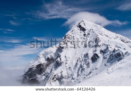 Peak of Jungfraujoch in Swiss Alps - stock photo