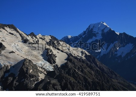 Peak of Mt Cook and glacier. Summer scene in New zealand. - stock photo