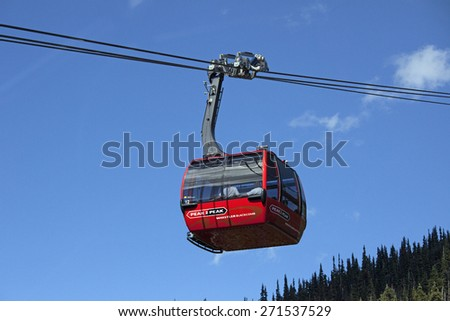 PEAK 2 PEAK - AUGUST 25, 2010: The longest free span of 3.03 km and highest point of 436 m above the ground - in the world, has lift gondola in Whistler. Gondola is in service since 2008. B.C., Canada - stock photo