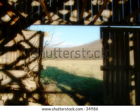 Peak through a barn in Kentucky - stock photo