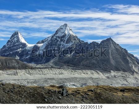 Peaks Nirekha (6169 m), Kangchung (6062 m), and Chola (6069 m) in the area of Cho Oyu - Gokyo region, Nepal, Himalayas - stock photo