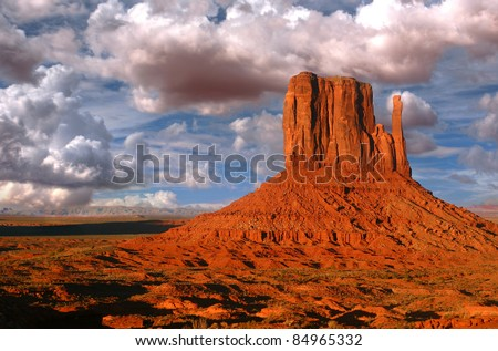 Peaks of rock formations in the Navajo Park of Monument Valley Utah known as The Mittens - stock photo
