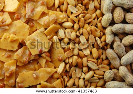 Peanut brittle and nuts in the shell and out. - stock photo