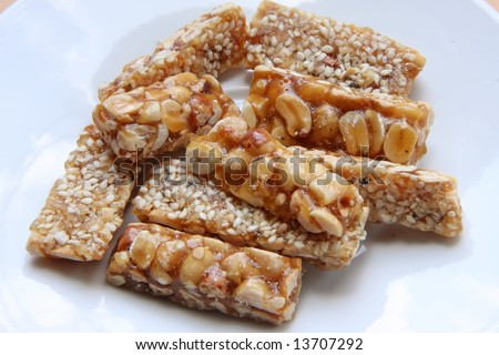 Peanut brittle sweet hard nut snack crunchy pieces - stock photo