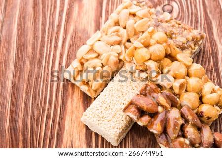 Peanut brittle sweet hard on wooden table - stock photo
